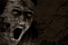 破旧石壁上恐怖尖叫的人物头像