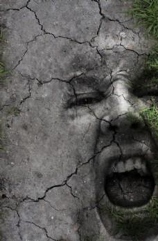 干裂土地上恐怖尖叫的人物头像